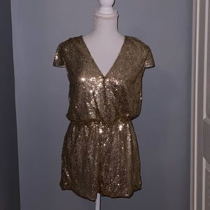 Gold sequence romper. Like new. Worn only once.